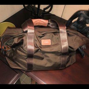 Unisex Large Tumi nylon duffle bag.